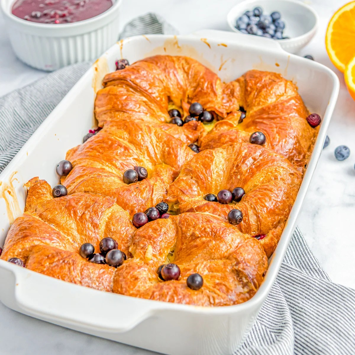 Square image of French Toast in baking dish.
