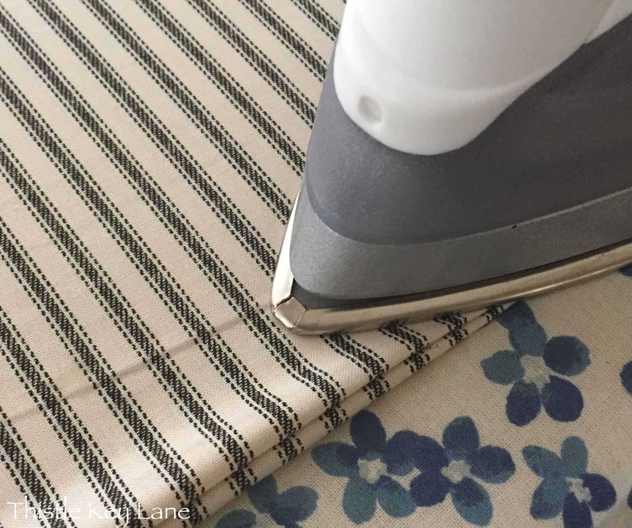 Iron fabric together to form a seam