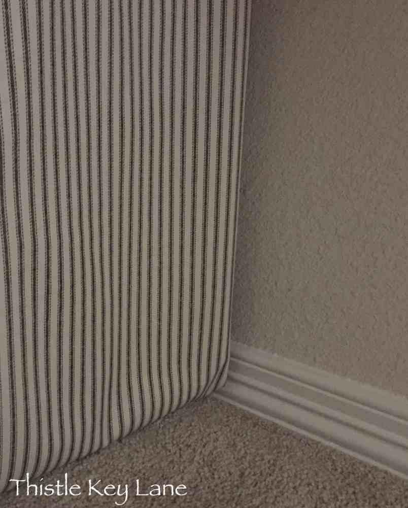 Simple ticking fabric and a tension rod to hide the storage