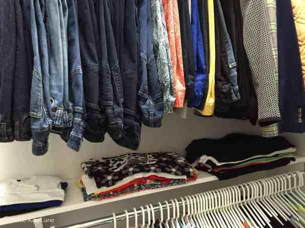 Sweaters and shirts folded on shelf