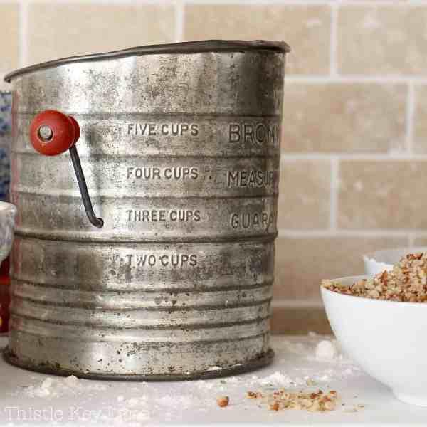 Vintage flour sifter for backing Sand Tarts.