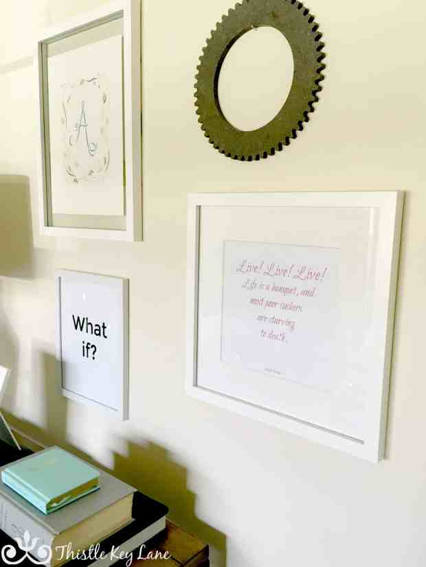 Gallery wall with room to add more fun quotes and whimsical objects.