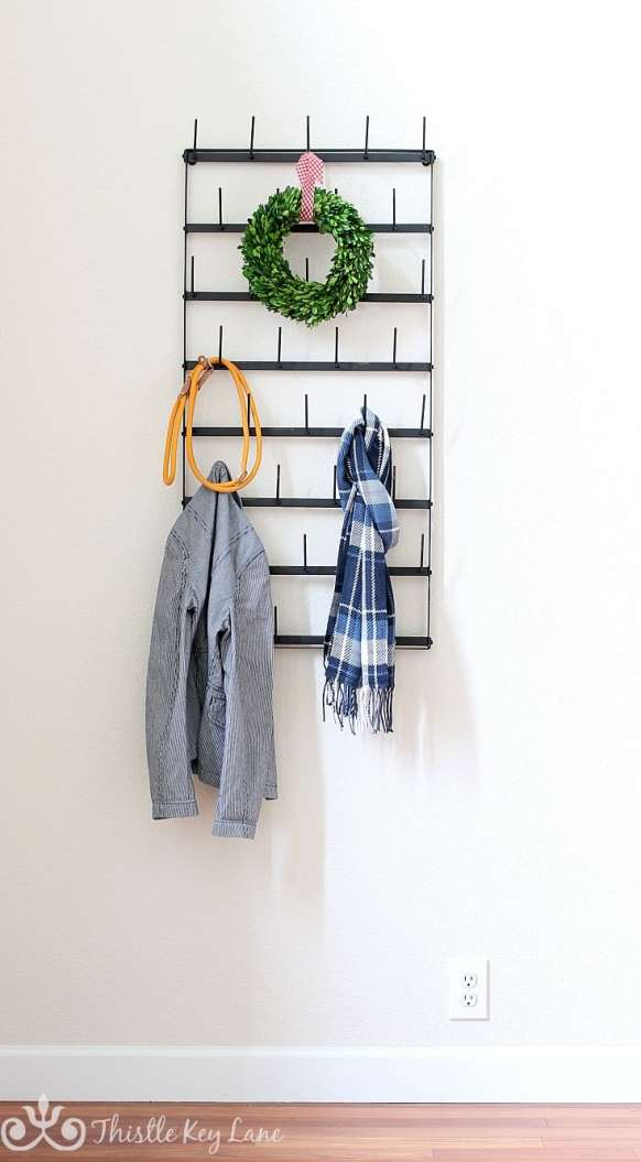 Metal cup rack turned into a coat rack.