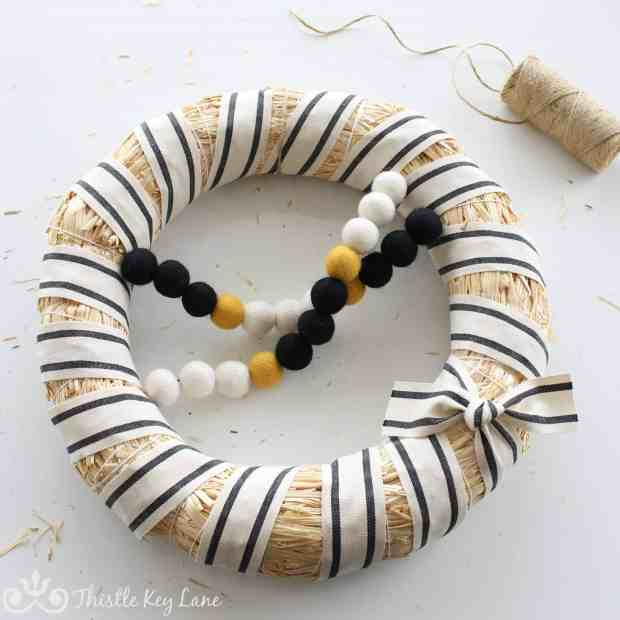 Winter white wreath with a pompom garland.