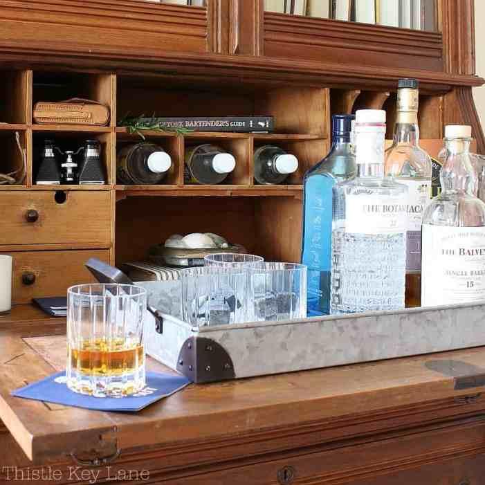 Galvanized tray help create a quick bar.