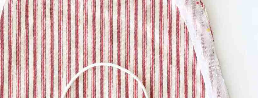 Bias tape pined around fabric