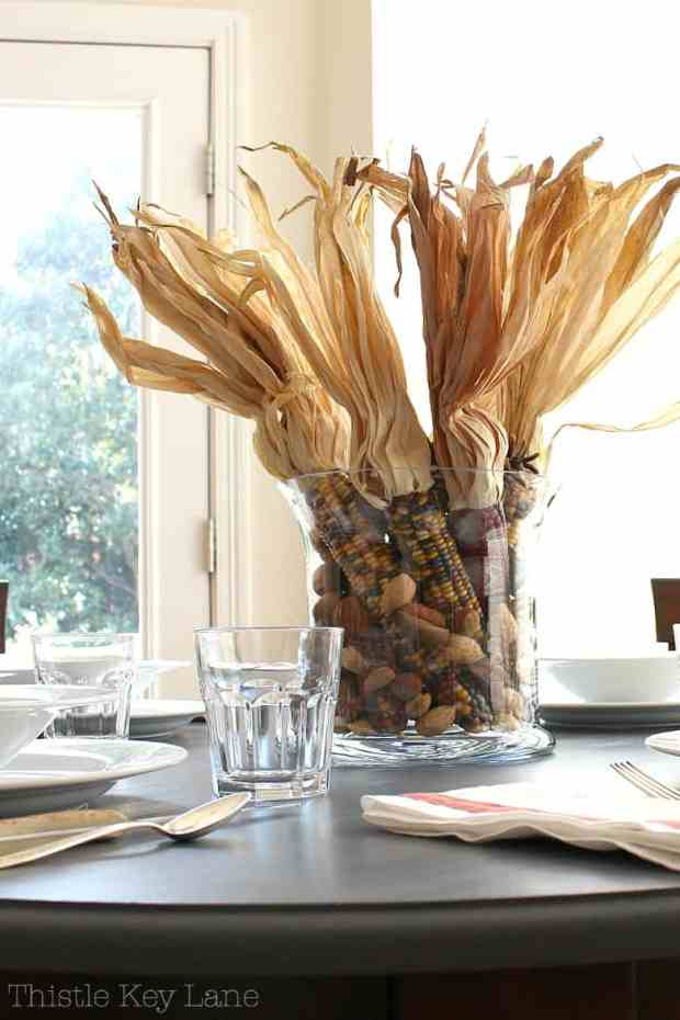 A beautiful casual table setting with a fall arrangement.