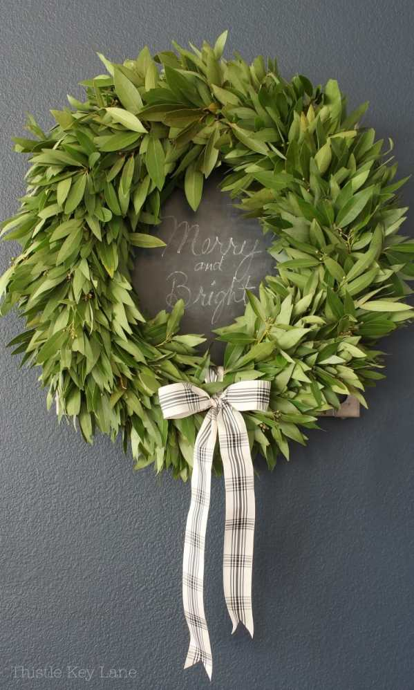 Merry and bright on the chalkboard and a wreath.