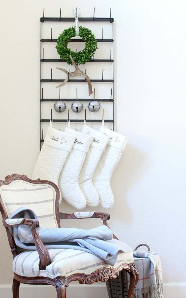 Cup rack in the foyer with stockings.