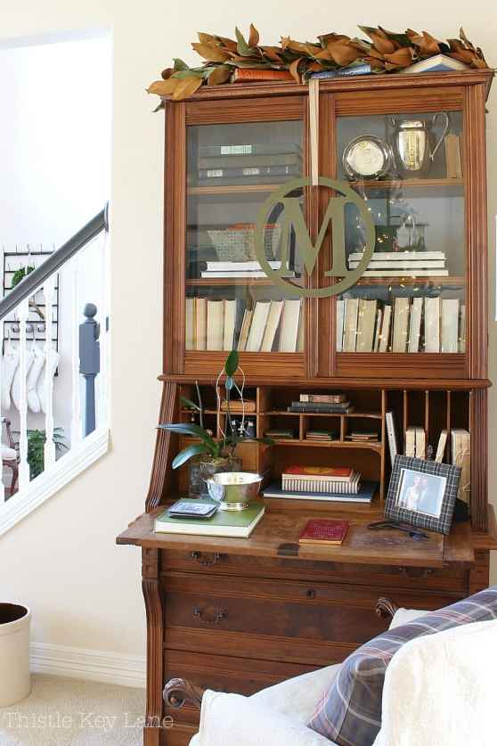 Love the magnolia garland on top of the bookcase.