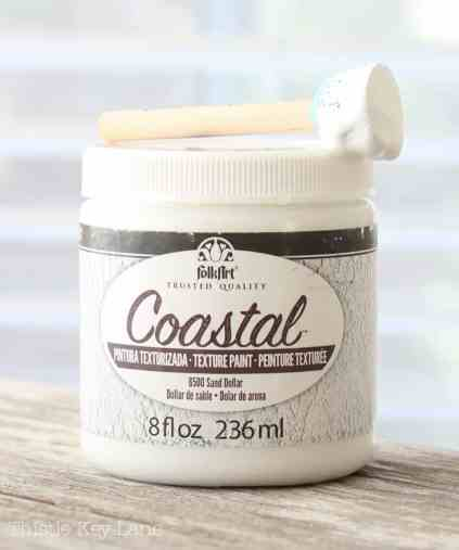 Coastal textured paint used to create a snowy effect.