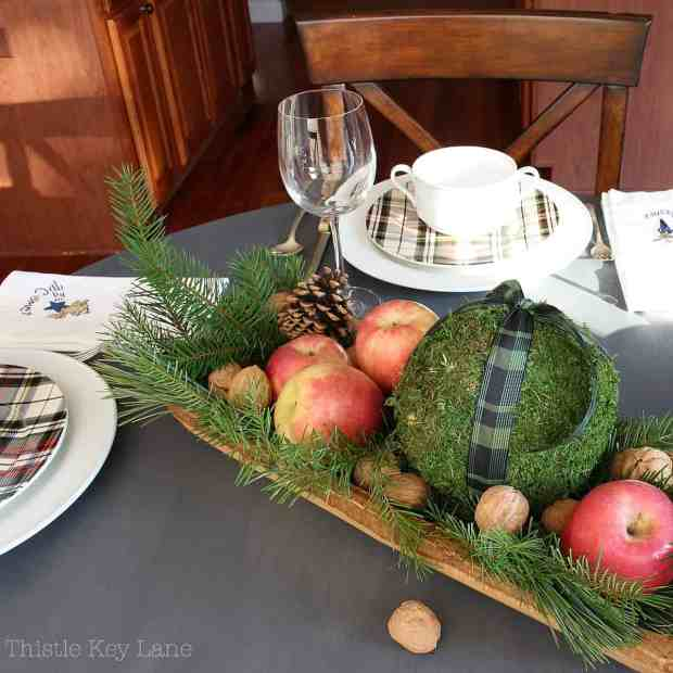 Holiday table with white and plaid dishes.