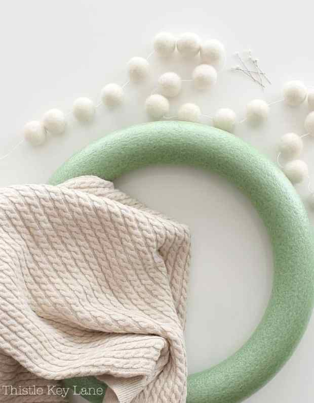 Supplies for a sweater wreath.