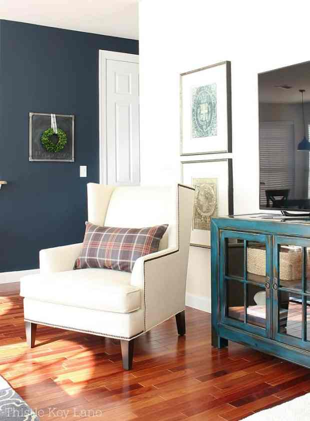 The navy accent wall sets a warm mood.