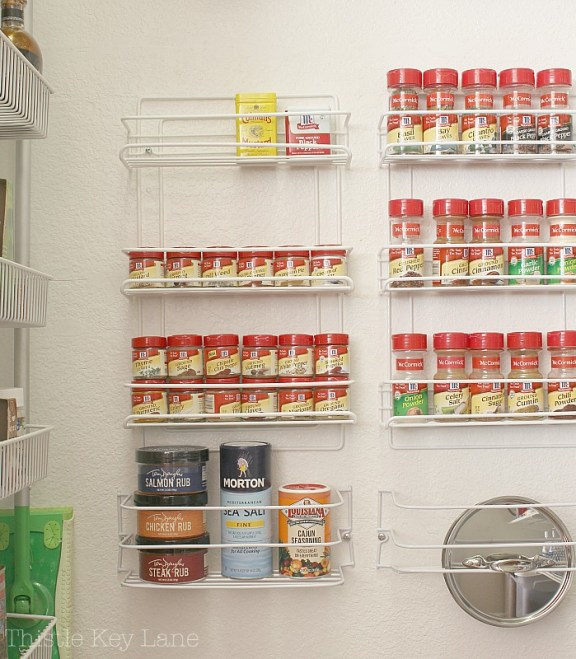 Larger wire racks hold larger spice containers and small lids.