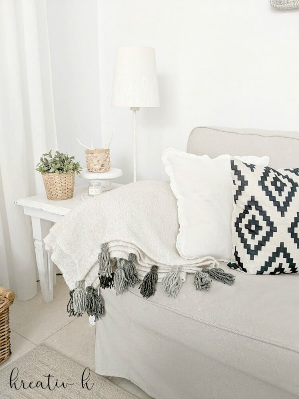 Kreativ K Beautiful Ikea hack tassel blanket.