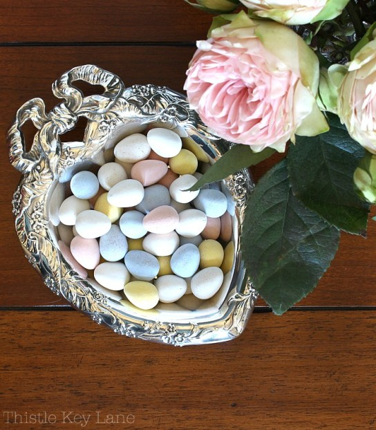 Sweet spring vignette with pastels.