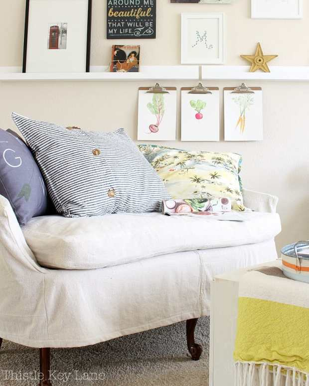 Slipcover love seat is perfect for this small space.