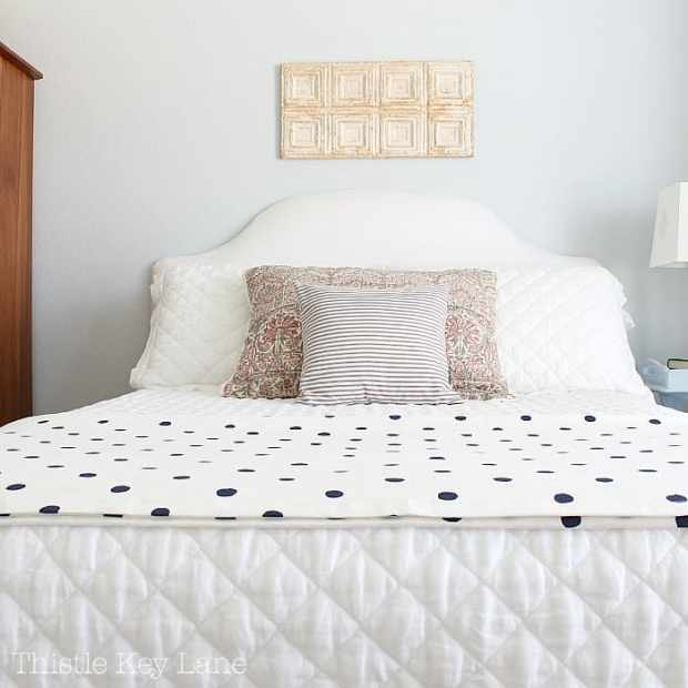 Soft bedding gives this bedroom a comfortable feel.