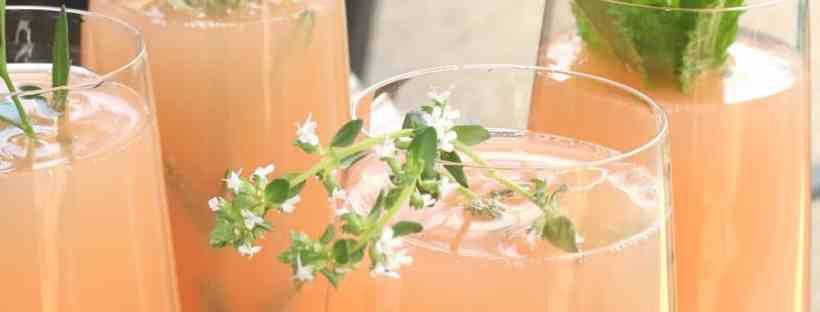 Pretty mimosas with herb garnish.