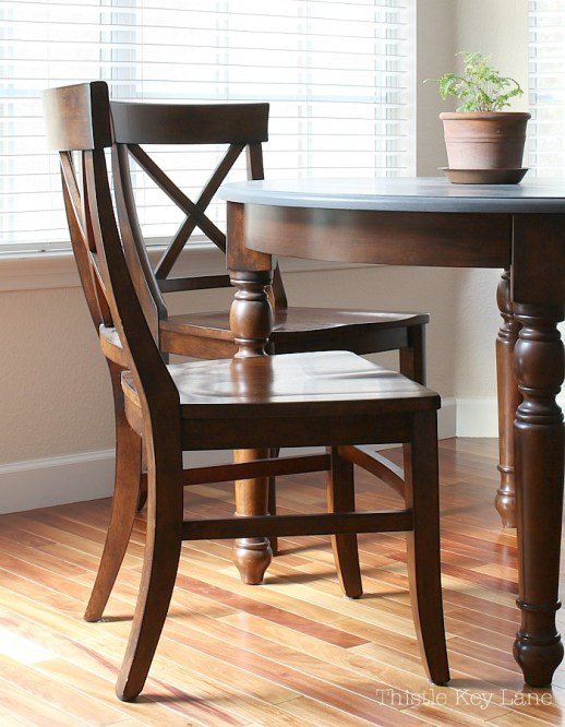 Dark finish of the kitchen chairs looked outdated.