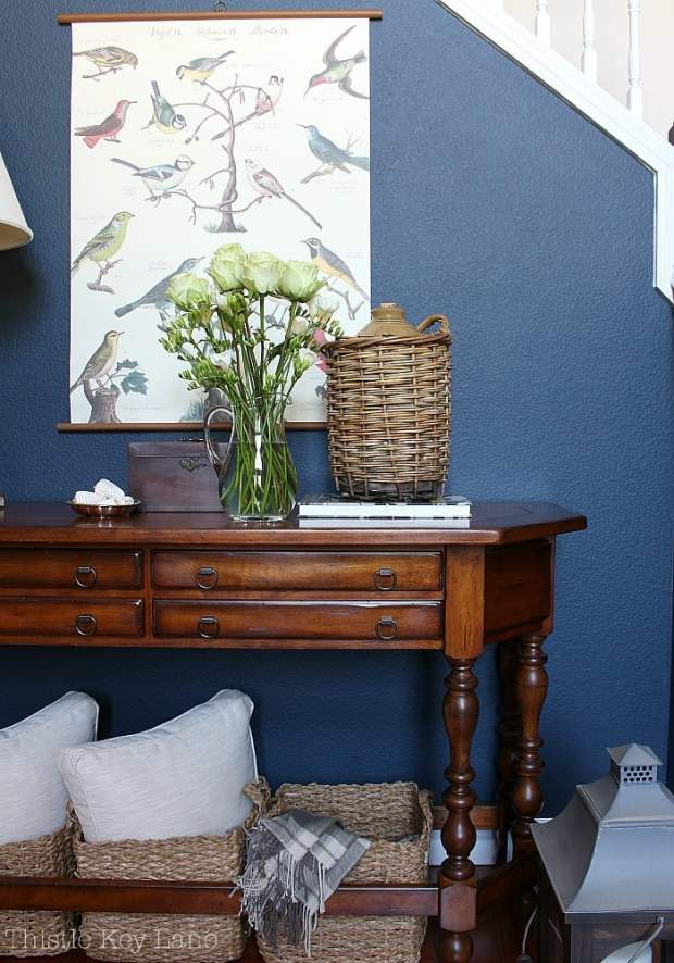 Summer home tour with blue and white accents in the entry way.