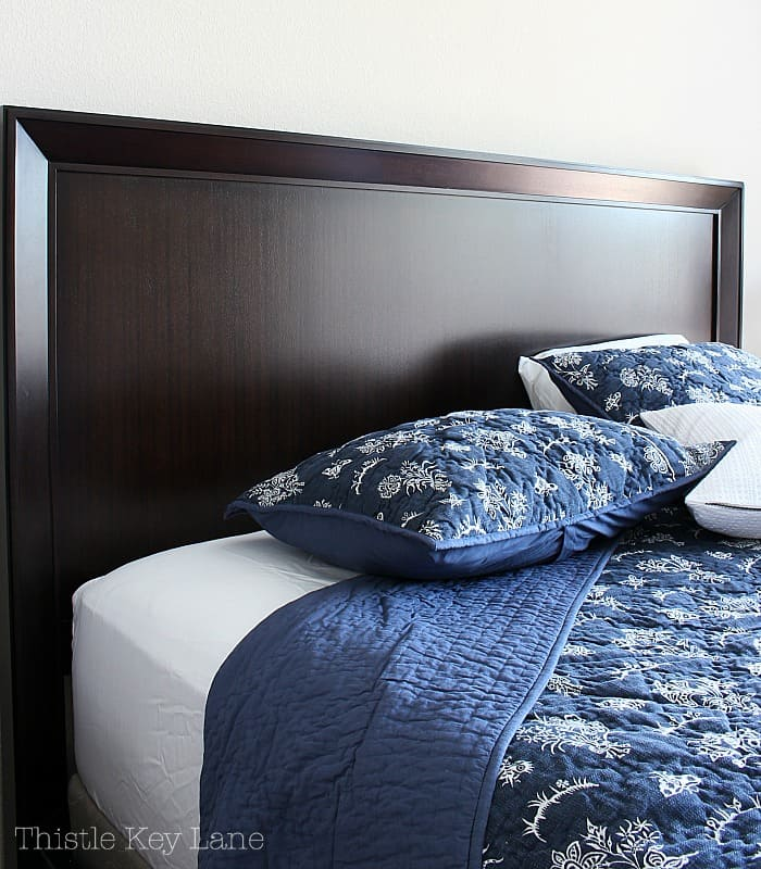 Masculine wood headboard in the master bedroom gets a makeover.