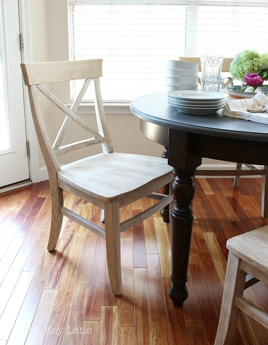 Great contrast of the light finish with the floor and table.