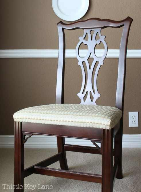 Dining room chair with old fabric.