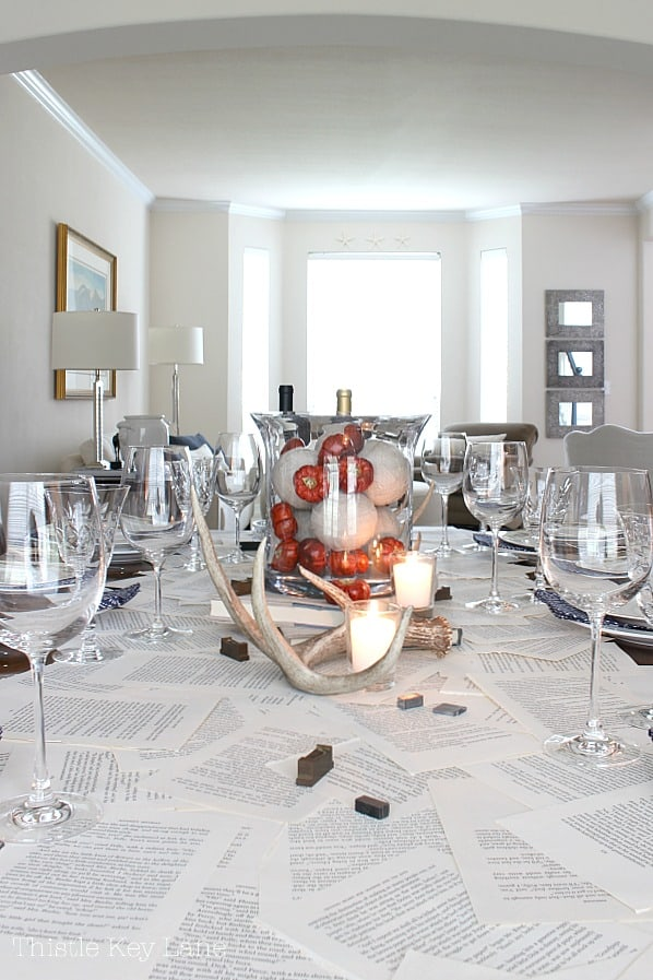 Tablescape using a book page table runner for an intimate dinner party.