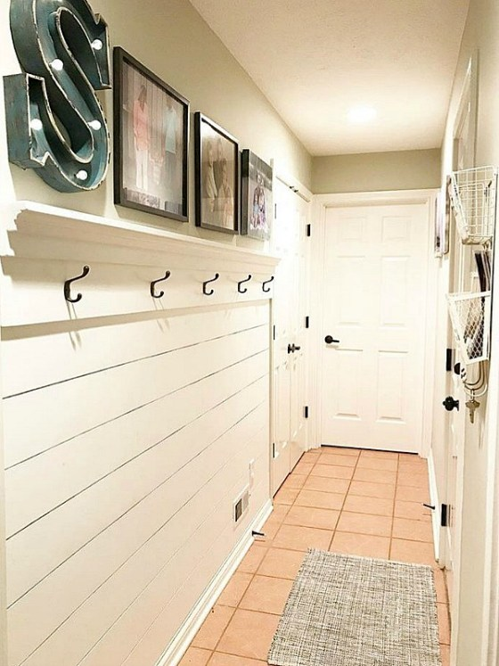 Sweet Farmhouse dreams created a mudroom in a hallway. Great use of space!