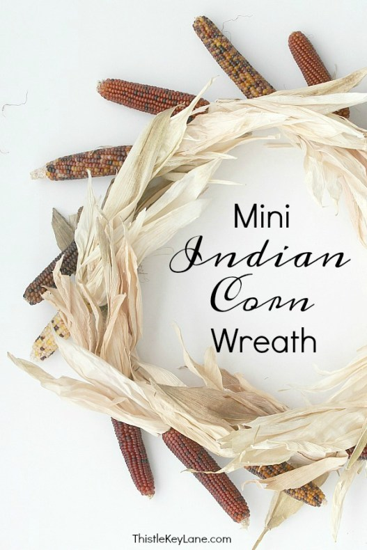 Mini Indian corn wreath with a white background.
