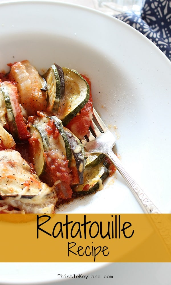 Baked eggplant, zucchini, tomatoes and onions served in a white bowl as a meal. Ratatouille Recipe.