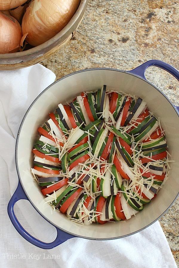 Fresh slices of eggplant, zucchini, tomatoes and onions. Ratatouille Recipe.