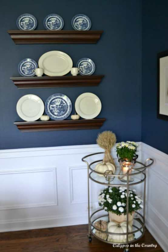 Round-bar-cart-in-navy-dining-room