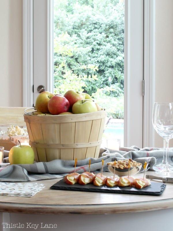 Bushel basket of apples with appetizers.