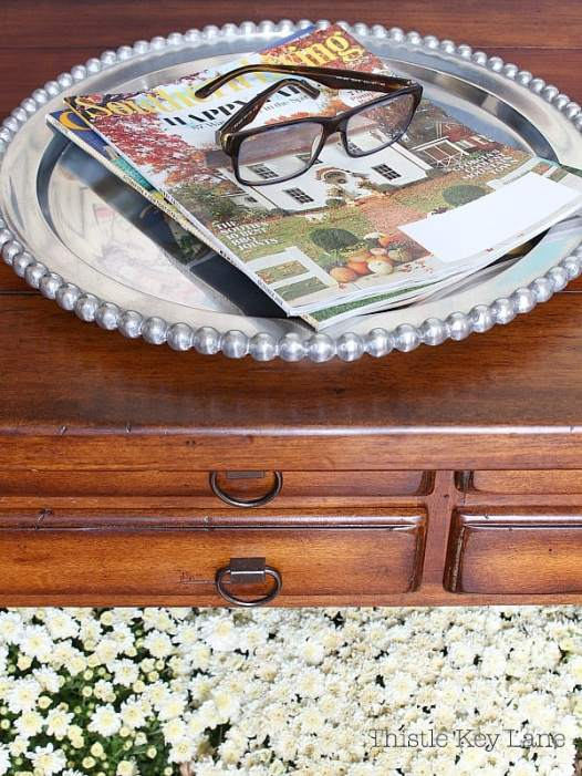 Entry table tray with fall magazines.