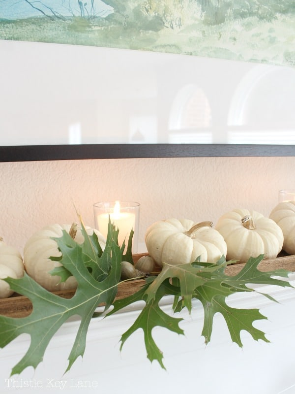 Oak leaves, acorns and pumpkins on the mantel.