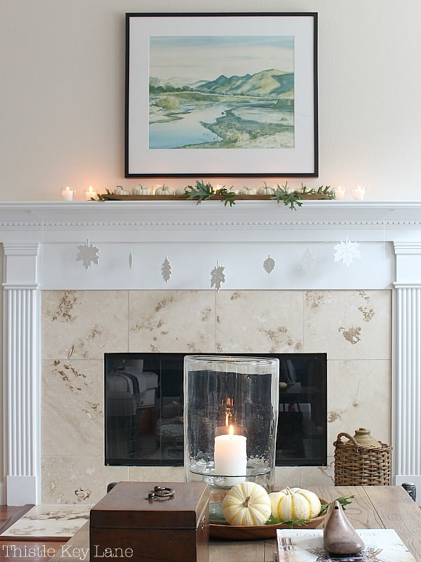 Decorating with candles on the mantel.