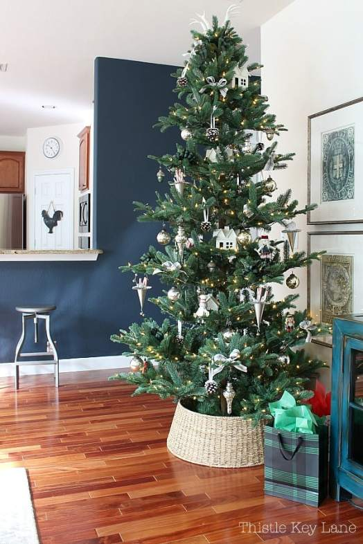 Full view of the tree with white and silver ornaments.
