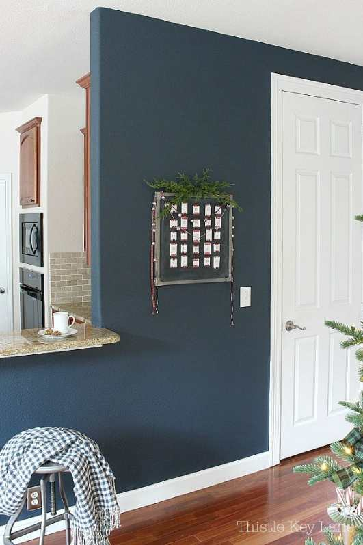 Chalkboard advent calendar on a navy wall.