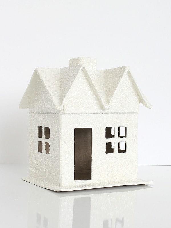 Paper mache house covered in glitter