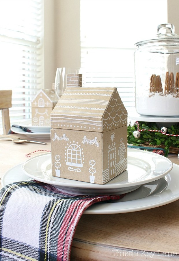 Gingerbread house with white chalk paint on a plate.