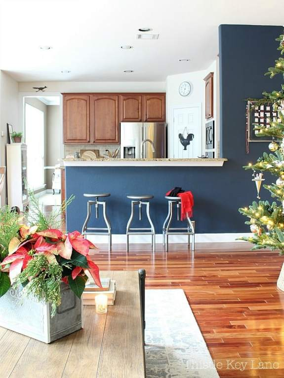 Poinsettia arrangement and a view of the room.
