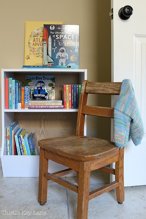 Brown wooden chair and book shelf.