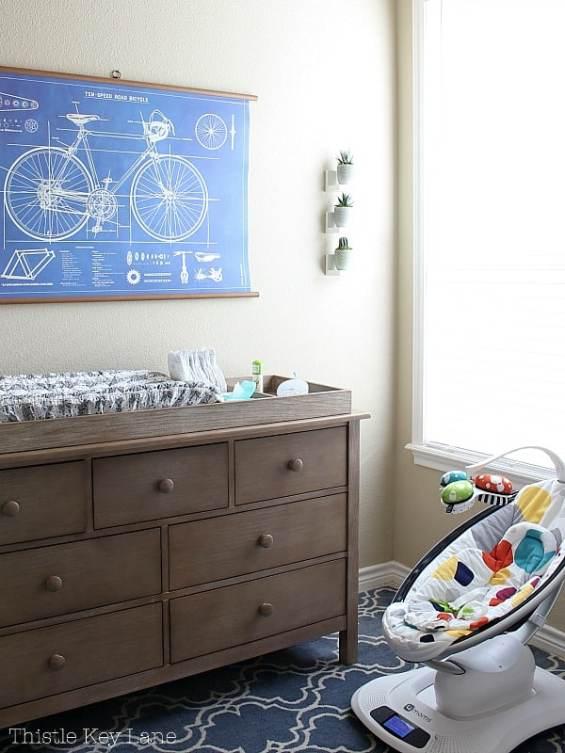 Bicycle blueprint chart over dresser.