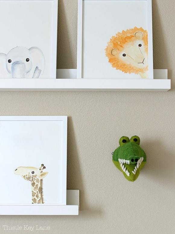 Framed animal watercolors and alligator head mount.
