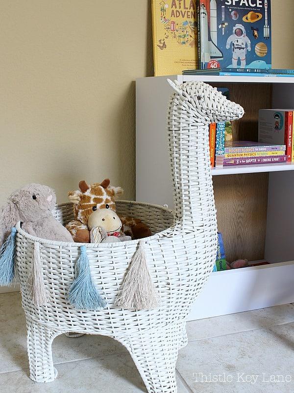 Llama basket with toys.