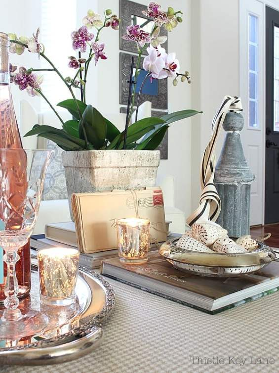 Valentine vignette with orchids, candles, books and sea shells.