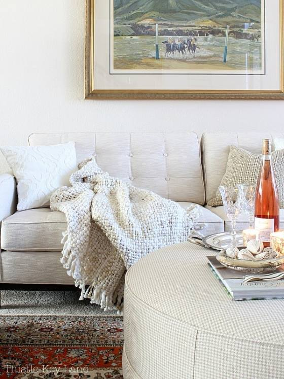 Valentine vignette with pillows and throw blanket.